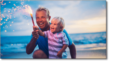 Father and Son holding Fireworks
