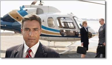Executive with Helicopter